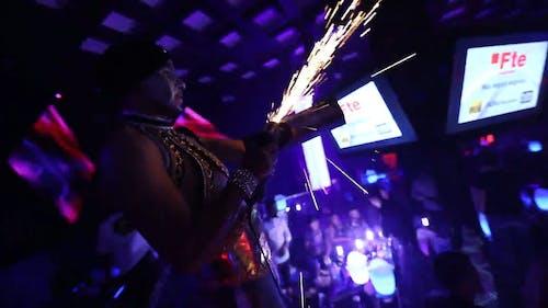 A Man in the Club Grinding a Metal Bar