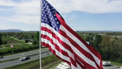 Done Footage Of The American Flag Raised On The Flag Pole
