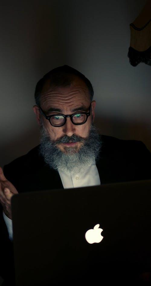 A Jewish Man Using A Laptop