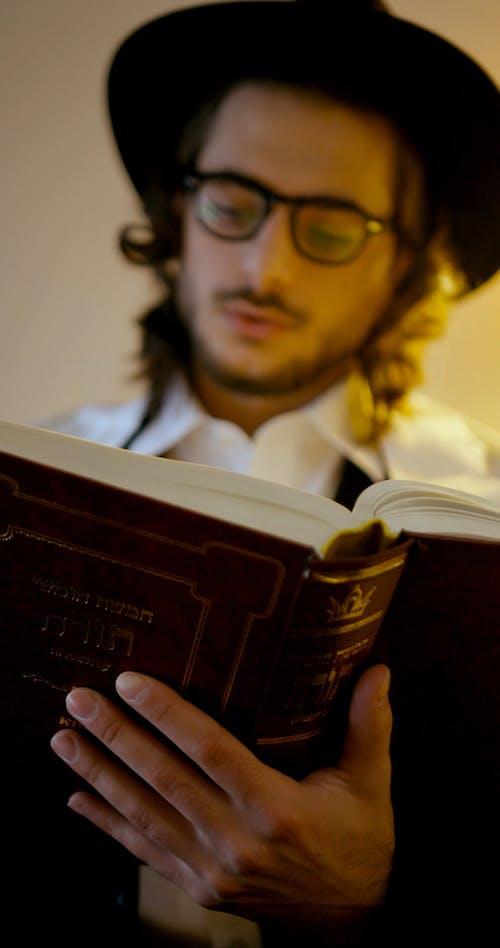 A Jewish Man Reading The Hebrew Bible