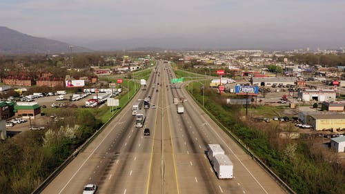 Drone Footage Of An Elevated Expressway Across A Town