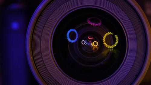 Round Colored Lights Reflection Over A Camera Lens