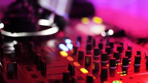 A Close-up Shot of a Deejay Mixer
