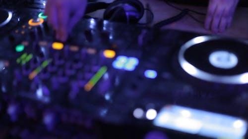 Person Using a DJ Mixer