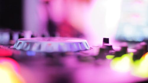Close-Up View of A Person Using His DJ Mixer