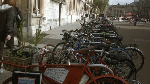 A Rows Of Bicycle Parked On The Street Side