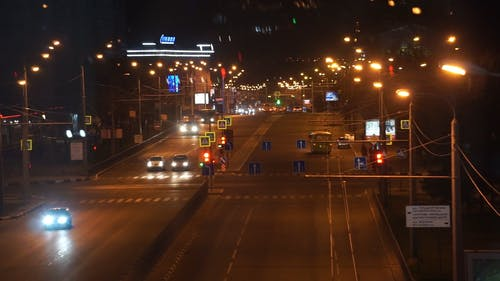 Street at Night with Lots of Cars Passing By
