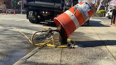 A Leaking Fire Hydrant In A Street Where Road Repairs Is Being Done