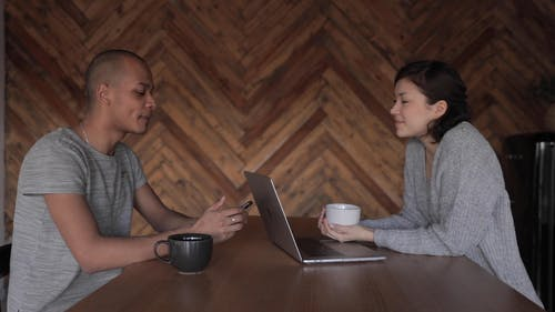 A Man and a Woman having Discussion about Work