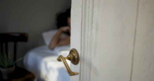 A Door Opens To See  Woman Woke Up From Sleep