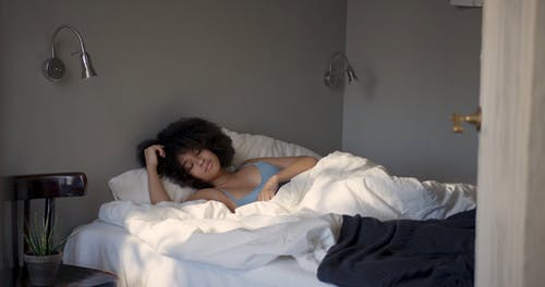 A Sexy Woman Waking Up From Sleep