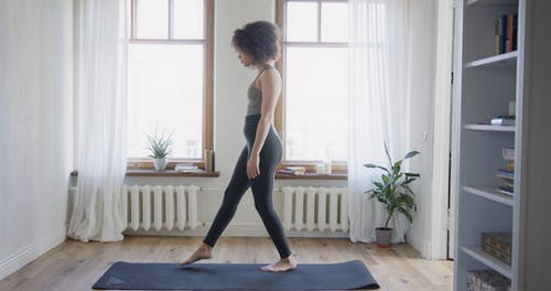 A Woman Doing Stretch Exercises At Home