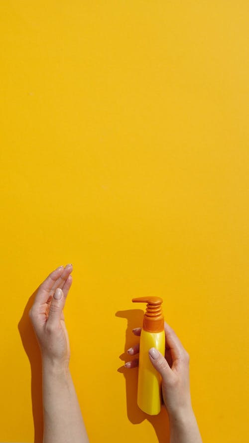 A Person Disinfecting Hands