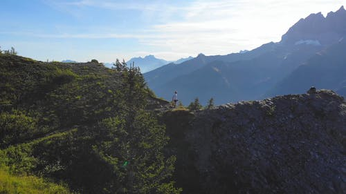 Drone Footage Of A Man Hiking The Mountain
