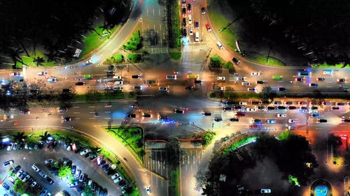 Evening Traffic On A Multi Section Road With Intersection