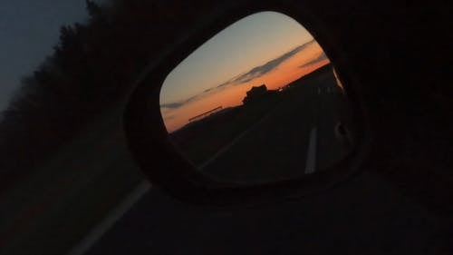 Sunrise Reflection From A Car Side Mirror