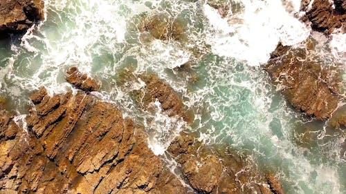 Sea Waves Breaking In The Rocky Shore