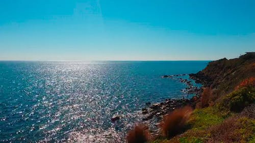 Blue Water Of The Sea Kisses The Rocky Coastline