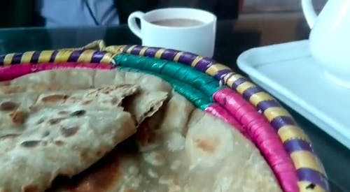 A Breakfast Of Chapati Bread And Hot Coffee