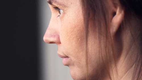 Close-up Footage Of A Woman Face In Side View