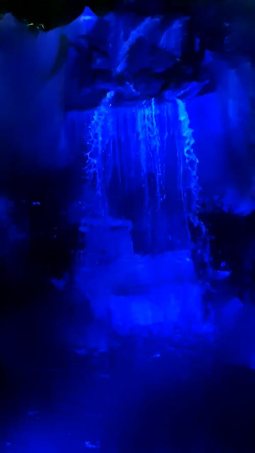 Blue Light Effect On A Man Made Waterfall