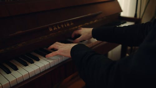 A Pianist Playing Music With The Piano