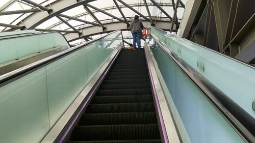 Using An Escalator In Going Up The Floors