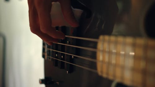 Close-up Footage Of A Hand Strumming The Guitar Strings