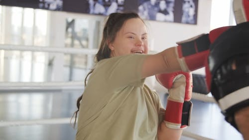 A Woman Throwing And Dodging Punches In A Boxing Exercise