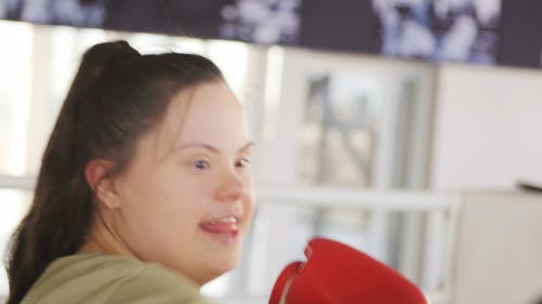 Girl With Down Syndrome Doing Boxing Workout
