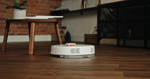 A Robotic Vacuum Cleaner Cleaning The Floor