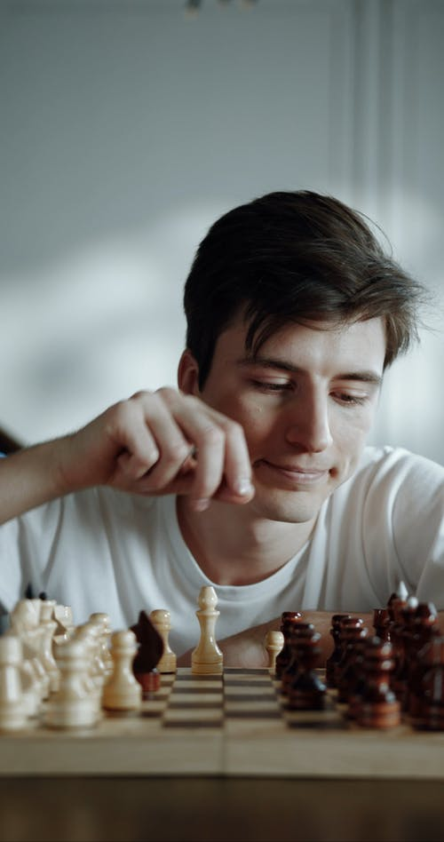 A Man Playing A Game Of Chess Alone