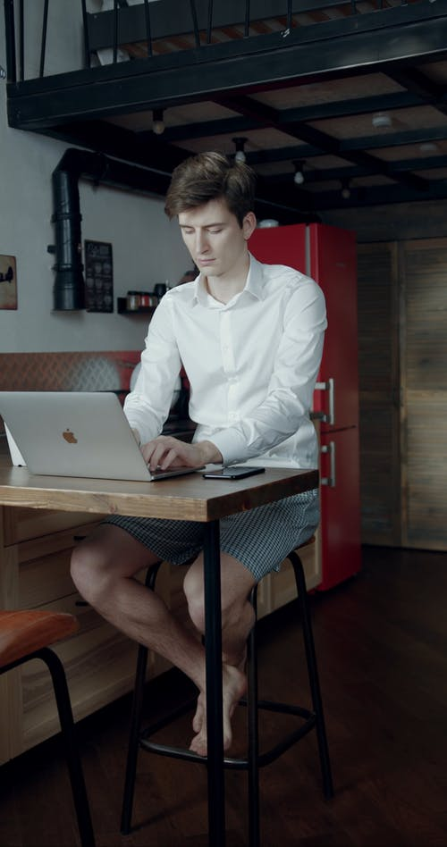 A Man Working On His Laptop While Staying At Home