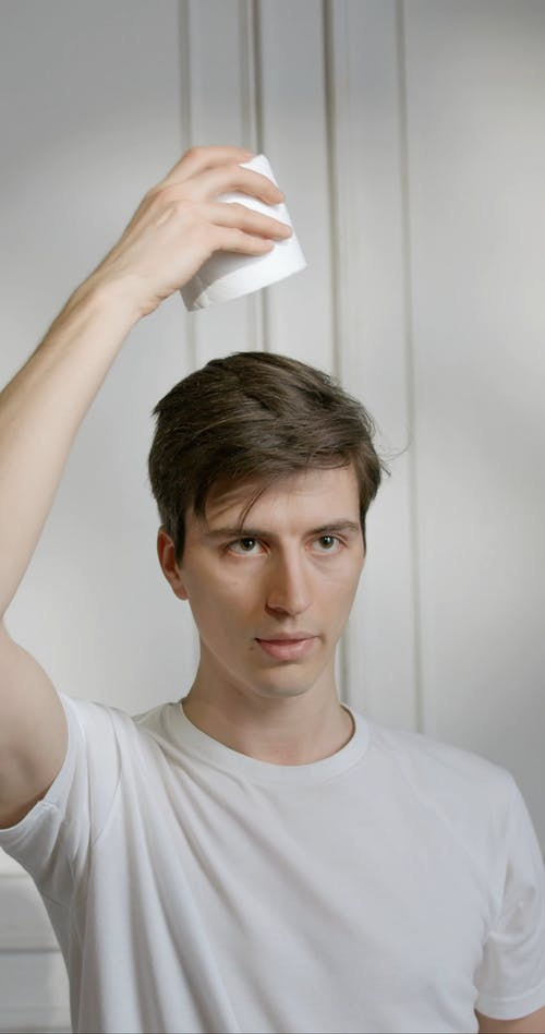 A Man Balancing Toilets Papers On His Head