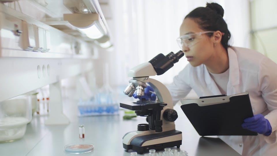 Video Of Female Chemist Looking Through Microscope