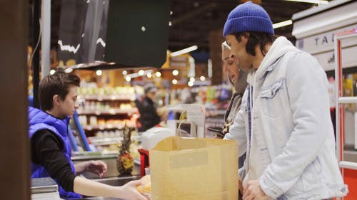A Couple Shopping For Food In A Supermarket