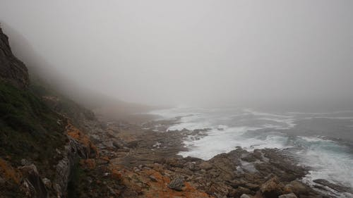 Time-Lapse Video of Rocky Beach Shore Under Foggy Weather