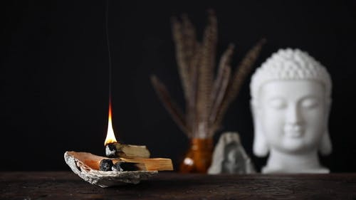 Burning Incense on Top of a Table