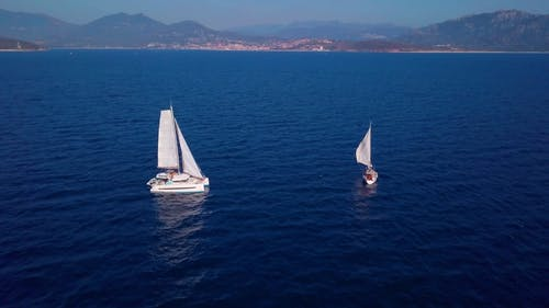 Aerial Video of Sail Boats in the Blue Sea Water