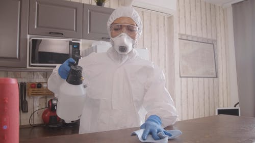Person Disinfecting a Tabletop