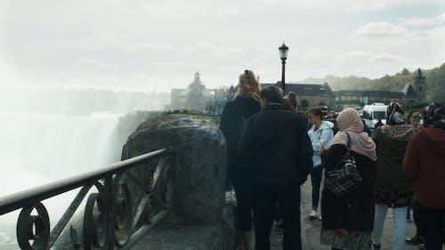 A Crowd Of Tourists Watching The Niagara Falls