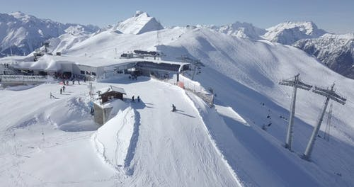 Drone Footage of People Skiing in Ski Resort