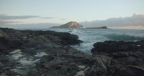 Strong Waves Crashing The Rocky Coast