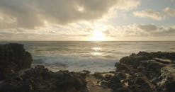Crashing Waves Hitting The Rock Shore