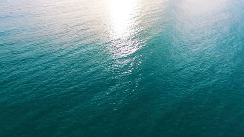 Drone Flying Above The Sea Surface