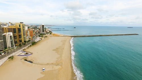 Drone Shot of Ocean Waves at the Seashore