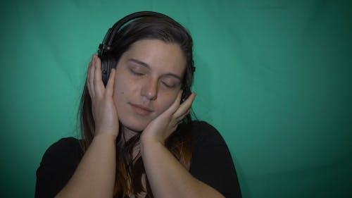 Woman Enjoying Listening To Music With Headphones