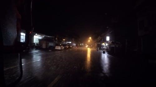Road Travel On A Rainy Night Using Public Transportation