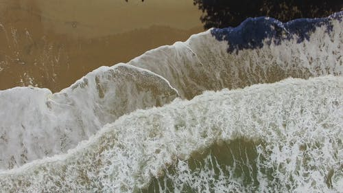 Drone Shot of Crashing Waves on the Beach