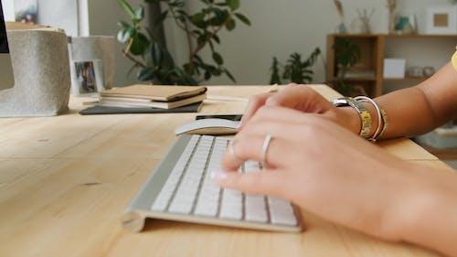A Woman Typing n A Wireless Keyboard